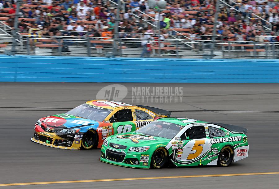 Mar. 3, 2013; Avondale, AZ, USA; NASCAR Sprint Cup Series driver Kasey Kahne (5) races alongside Kyle Busch (18) during the Subway Fresh Fit 500 at Phoenix International Raceway. Mandatory Credit: Mark J. Rebilas-