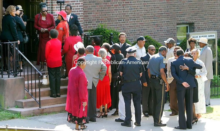 """WATERBURY, CT. 17 July 2006--071706SV02--Mourners line up to enter the funeral of Catherine """"Kay"""" E. Wyrick at Grace Baptist Church in Waterbury Monday. Wyrick was well known in the city, state and around the nation for her advocacy for children's issues. Steven Valenti Republican-American"""