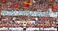 """Calcio: allenamento a porte aperte """"Open Day"""" per la presentazione della Roma, a Roma, stadio Olimpico, 21 agosto 2013.<br /> AS Roma players face fans at the club's Open Day training session at Rome's Olympic stadium, 21 August 2013. The banner reads """"Inability to remedy a defeat is worse than the defeat itself"""", referring to the Italy Cup final match lost agains Lazio's city rivals, on last 26t May.<br /> UPDATE IMAGES PRESS/Riccardo De Luca"""