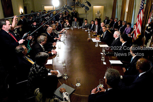 Washington, D.C. - April 20, 2009 -- United States President Barack Obama holds his first Cabinet meeting in the Cabinet Room of the White House in Washington, D.C. on Monday, April 20, 2009..Credit: Ron Sachs / Pool via CNP