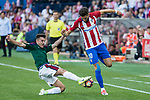 Aitor Bunel of Club Atletico Osasuna competes for the ball with Yannick Ferreira Carrasco of Atletico de Madrid during the match of La Liga between  Atletico de Madrid and Club Atletico Osasuna at Vicente Calderon  Stadium  in Madrid, Spain. April 15, 2017. (ALTERPHOTOS / Rodrigo Jimenez)