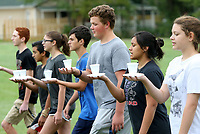 NWA Democrat-Gazette/DAVID GOTTSCHALK   Gabe Salsbury (third from right), the baritones section leader, competes Monday, August 7, 2017, against other Heritage High School Marching Band section leaders at holding a cup of water without spilling during rehearsal at the school in Rogers. The section leaders were competing for candy in the marching drill that emphasized keeping their torso and arms still when marching.