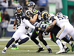 St. Louis Rams Maurice Alexander (31), James Laurinaitis (55) and William Hayes (95) bring down Seattle Seahawks running back Christian Michael (32) at CenturyLink Field in Seattle, Washington on December 27, 2015.  The Rams beat the Seahawks 23-17.      ©2015. Jim Bryant Photo. All Rights Reserved