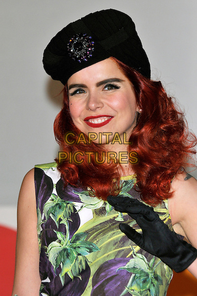 Paloma Faith.The Brit Awards 2012 arrivals, O2 Greenwich, London, England..21st February 2012.Brits headshot portrait black hat brooch purple sleeveless green floral print hand glove.CAP/PL.©Phil Loftus/Capital Pictures.