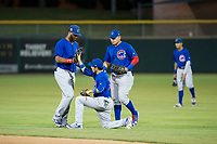 AZL Cubs second baseman Carlos Sepulveda (16) is helped up by right fielder Jonathan Sierra (22) and Luis Hidalgo (18) after making a catch against the AZL Giants on September 7, 2017 at Scottsdale Stadium in Scottsdale, Arizona. AZL Cubs defeated the AZL Giants 13-3 to win the Arizona League Championship Series two games to one. (Zachary Lucy/Four Seam Images)