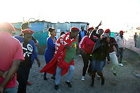 Supporters of populist South African leader Julius Malema go door to door to recruit new members in Gugulethu, a township outside Cape Town, South Africa. Malema's Economic Freedom Front (EFF) party is the new radical party that attracts members of the youth and unemployed for the upcoming fifth democratic elections on May 7, 2014. The party calls for 'real freedom' for the black majority and they have suggested the seizure of farms from white owners and the nationalization of mines. Photo by: Per-Anders Pettersson