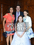 Kyra Duff Fedigan who recieved first holy communion in the church of Mary Immaculate collon pictured with parents Alan and Lisa and sister Ellis. Photo:Colin Bell/pressphotos.ie