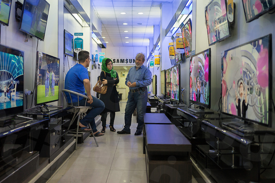 June 29, 2014 - Shiraz, Iran. Locals are seen in an electronics shop selling high-end flat screen television sets. © Thomas Cristofoletti / Ruom