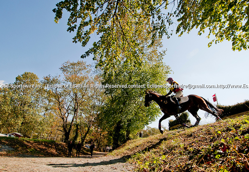 Susan Beebee competes aboard Wolf in the CCI2* division during the Cross Country Test at the Dansko Fair Hill International 3-Day Event in Fair Hill, Maryland on October 15, 2011.