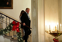 United States President Donald J. Trump and First Lady Melania Trump descend the Grand Staircase as they arrive at the Congressional Ball at White House in Washington on December 15, 2018. <br /> Credit: Yuri Gripas / Pool via CNP / MediaPunch