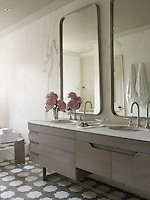 In the master bathroom a pair of Volpe-designed mirrors hangs on walls sheathed in Calacatta marble