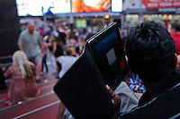 "A man uses his mobile device in Times Square in New York, July 15, 2012. New York CIty recently unveiled plans to turn outdated public payphone infrastructure into free WiFi hotspots, according to Mashable. New Yorkers and visitors alike will be able to connect to ""NYC-PUBLIC-WIFI"" using smartphones, tablets, or laptops. local media reported. Photo by Eduardo Munoz Alvarez / VIEW."