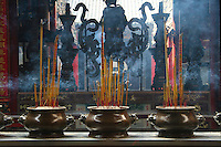 Joss Sticks Burning at Thien Hau Pagoda - <br /> Joss sticks are a type of incense used in many East Asian countries, traditionally burned before a Chinese religious image, idol or shrine. They can also be burned in front of a door, or open window as an offering to heaven.
