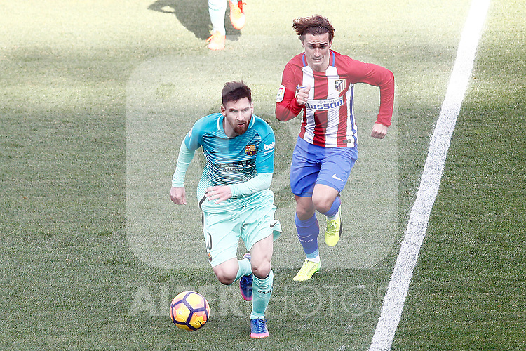 Atletico de Madrid's Antoine Griezmann (r) and FC Barcelona's Leo Messi during La Liga match. February 26,2017. (ALTERPHOTOS/Acero)