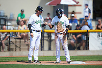 Clinton LumberKings manager Scott Steinmann (22) fist bumps Pat Leyland (23) during a game against the Great Lakes Loons on August 16, 2015 at Ashford University Field in Clinton, Iowa.  Great Lakes defeated Clinton 3-2.  (Mike Janes/Four Seam Images)