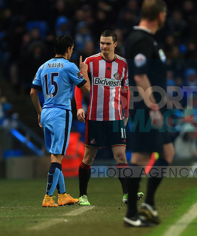 Jesus Navas of Manchester City warns Adam Johnson of Sunderland following a coming together - Manchester City vs. Sunderland - Barclay's Premier League - Etihad Stadium - Manchester - 28/12/2014 Pic Philip Oldham/Sportimage