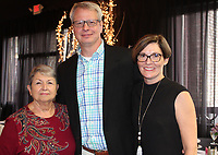 NWA Democrat-Gazette/CARIN SCHOPPMEYER Gail Eads (from left) and David Pieper and Eva Madison gather at the Peace at Home lunceheon. Eads and Pieper were presented Courage Awards.