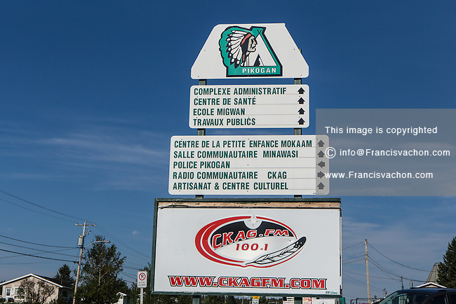 A sign directing to various services is pictured in the Indian reserve of Pikogan, home of the Abitibiwinni First Nation, near Amos, Canada Wednesday August 24, 2016.