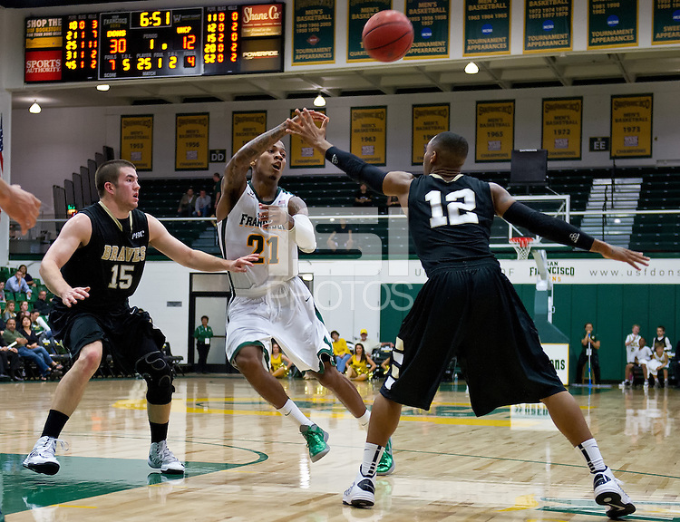 SAN FRANCISCO, CA - November 5, 2012: University of San Francisco Dons vs UNC Pembroke Braves at the War Memorial Gym in San Francisco, California. Final score San Francisco Dons 94 the UNC Pembroke Braves 57.