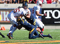 October 20th, 2012: California's Kameron Jackson and Nathan  Broussard tackles Stanford's Zach Ertz during a game at Memorial Stadium at Berkeley, Ca   Stanford defeated California 21 - 3