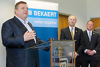 NWA Democrat-Gazette/DAVID GOTTSCHALK  Greg Hines (from right), mayor of Rogers, and Asa Hutchinson, governor of Arkansas, listen to Matthew Taylor, chief executive officer of Bekaert, speak Wednesday, March 23, 2016, at the manufacturing plant in Rogers. The company announced a $32 million expansion and the creation of an additional 100 new jobs.