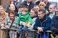St Patricks Day parade High Street Digbeth.Group of people watching the Parade Location probably Floodgate St juction of High St