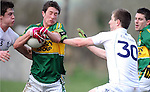 25-02-12: David O'Callaghan, Kerry, under pressure from Emmet Bolton and Kieran Dowling, Kildare, during the senior football challenge match between Kerry and Kildare at the Ballymacelligott GAA Club official pitch reopening on Saturday.  Picture: Eamonn Keogh (MacMonagle, Killarney)