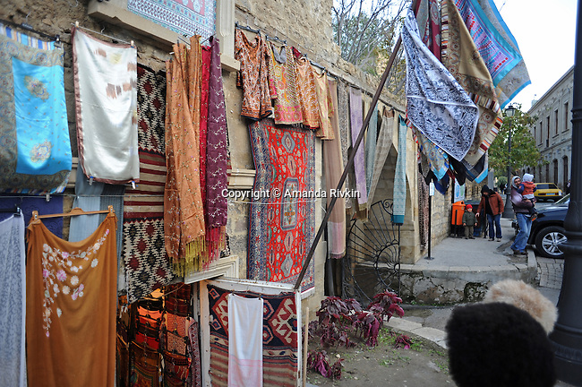Silk scarves are seen on sale in the Old City of Baku, Azerbaijan on November 16, 2011.