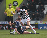 Grant Munro and Sam Parkin challenge for the ball in the St Mirren v Ross County Clydesdale Bank Scottish Premier League match played at St Mirren Park, Paisley on 19.1.13.