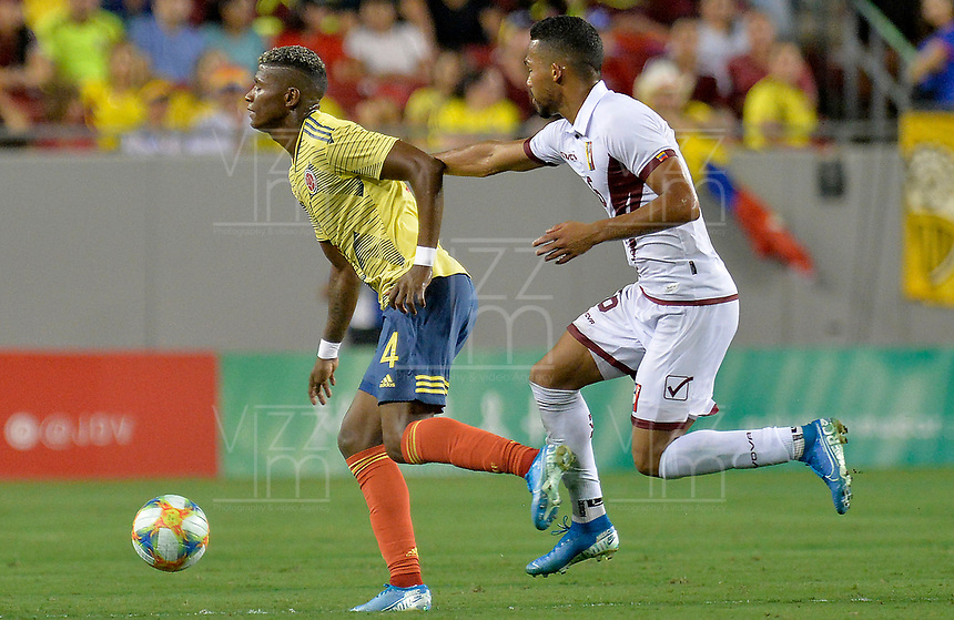 TAMPA - ESTADOS UNIDOS, 10-09-2019: Luis Manuel Orjuela jugador de Colombia disputa el balón con Yangel Herrera jugador de Venezuela durante partido amistoso amistoso entre Colombia y Venezuela jugado en el Raymond James Stadium en Tampa, Estados Unidos. / Luis Manuel Orjuela player of Colombia fights the ball with Yangel Herrera player of Venezuela during a friendly match between Colombia and Venezuela played at Raymond James Stadium in Tampa, Estados Unidos Photo: VizzorImage / Cristian Alvarez / Cont