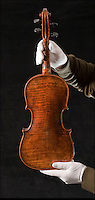BNPS.co.uk (01202 558833)<br /> Pic: Phil Yeomans/BNPS<br /> <br /> And the band played on...<br /> <br /> The violin played by the bandmaster on the Titanic as the ship was sinking is finally being auctioned for an estimated &pound;400,000.<br /> <br /> The wooden instrument has been proven to be the one used by Wallace Hartley as his band famously played on to help keep the passengers calm during the disaster.<br /> <br /> Its existence and survival only emerged in 2006 when the son of an amateur violinist who was gifted it by her music teacher in the early 1940s contacted an auctioneers.