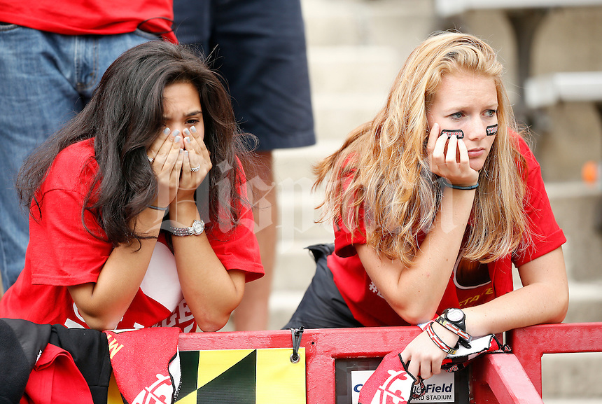 University of Maryland students Jacqueline Hyman, 18, left, and Hope Goodman, 19, watch the Terrapins during the third quarter of the NCAA football game against the Ohio State Buckeyes at Byrd Stadium in College Park, Maryland on Oct. 4, 2014. The Terps lost 52-24. (Adam Cairns / The Columbus Dispatch)