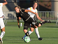23 July 2009:  Tiffeny Milbrett of the FC Gold Pride dribbles the ball away from Camille Abily of the Los Angeles Sol during the first half of the game at Buck Shaw Stadium in Santa Clara, California.   FC Gold Pride tied Los Angeles Sol, 0-0.