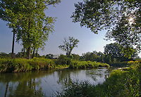 Nippersink Creek flows through a later summer grassland, Glacial Park, McHenry County, Illinois