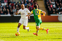 Andre Ayew of Swansea City  takes the ball past Robbie Brady of Norwich City  during  the Barclays Premier League match between Swansea City and Norwich City played at the Liberty Stadium, Swansea  on March the 5th 2016