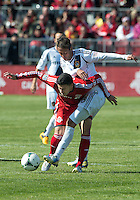 30 March 2013:Toronto FC midfielder Jonathan Osorio #21 and Los Angeles Galaxy midfielder Marcelo Sarvas #8 in action during an MLS game between the LA Galaxy and Toronto FC at BMO Field in Toronto, Ontario Canada..The game ended in a 2-2 draw..