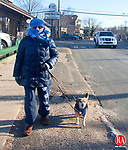 WATERBURY CT- JANUARY 07 2015 010715DA01- Eleanor Regan of Waterbury bundels up to walks Lizzie during Wednesday morning frigid temeratures. Regan says its freezing but Lizzie needs to walk and is worth it.<br /> Darlene Douty Republican American