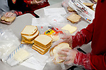 WOODBURY, CT-012218JS02--Students prepare sandwiches during the 5th annual Sandwich-Making Event held Monday at Woodbury Middle School. The event, led my Woodbury Middle School Athletics, invited participants to help prepare 500 sandwiches to be donated to the St. Vincent DePaul Shelter in Waterbury. <br /> Jim Shannon Republican-American