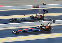 Apr. 14, 2012; Concord, NC, USA: NHRA top fuel dragster driver Dom Lagana (near lane) races alongside Bob Vandergriff Jr during qualifying for the Four Wide Nationals at zMax Dragway. Mandatory Credit: Mark J. Rebilas-
