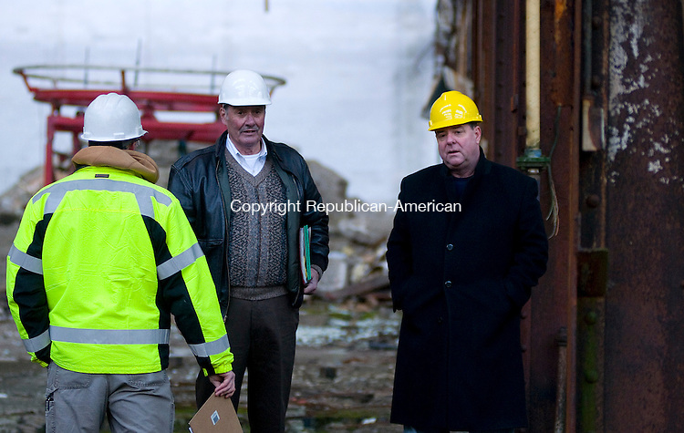 WATERBURY, CT-01062012--010612JS09---Waterbury Mayor Neil O'Leary, right, takes a tour of the old Waterbury Industrial Commons building on Thomaston Ave. in Waterbury on Friday. with James Mullen, volunteer project manager for the city of Waterbury, center, and Michael J. Jannitto a geologist for Woodward and Curran, left. .Jim Shannon Republican-American