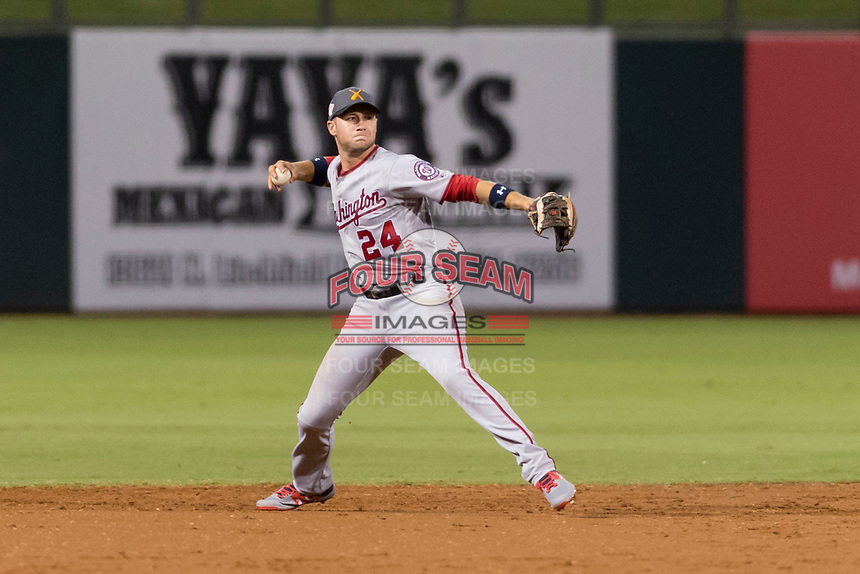 AFL East infielder Carter Kieboom (24), of the Salt River Rafters and the Washington Nationals organization, throws to first base during the Arizona Fall League Fall Stars game at Surprise Stadium on November 3, 2018 in Surprise, Arizona. The AFL West defeated the AFL East 7-6 . (Zachary Lucy/Four Seam Images)