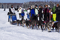 Sunday, March 4, 2012  John Baker getting high fives from fans on Long Lake at the restart of Iditarod 2012 in Willow, Alaska.