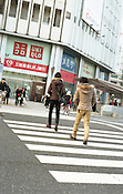 Crossing the street to Uniqlo and the Mitsubishi Tokyo UFJ Bank on the official 2,672nd anniversary of Japan.