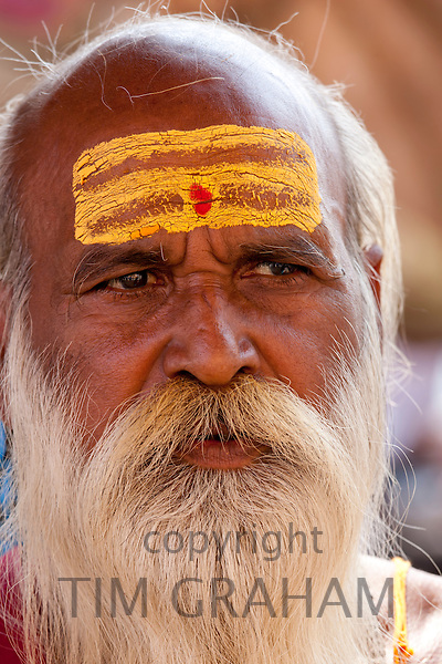 Hindu Sadhu holy man with traditional markings of symbol of Shiva in street in holy city of Varanasi, Benares, Northern India