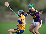 Mikey O Neill of Clare in action against Shaun Murphy of Wexford during the Jack Lynch Memorial game at Tulla. Photograph by John Kelly.