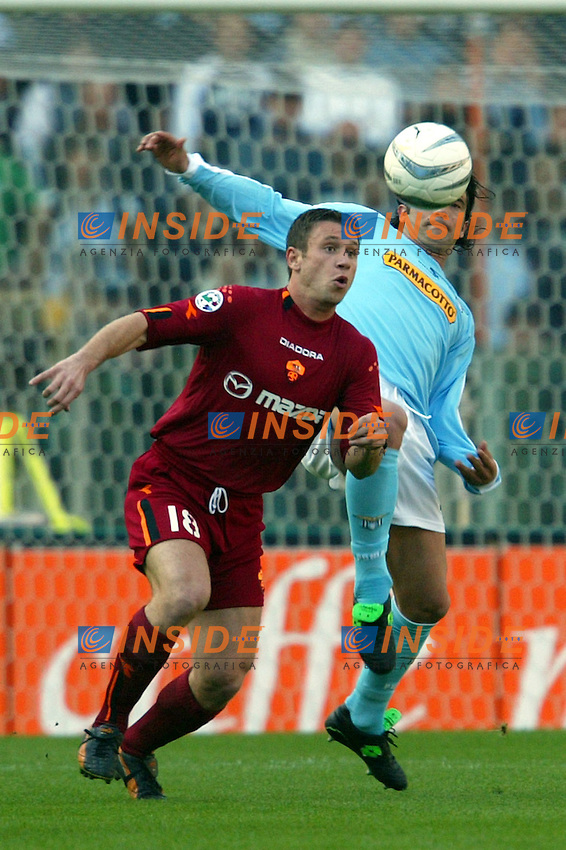 Roma 21/4/2004 Campionato Italiano Serie A <br /> Lazio - Roma 1-1 <br /> Antonio Cassano (Roma) and Fernando Couto (Lazio)<br /> Lazio and Roma are playing again after it was suspended on March 21, 2004, for security reasons.  <br /> Foto Andrea Staccioli Insidefoto