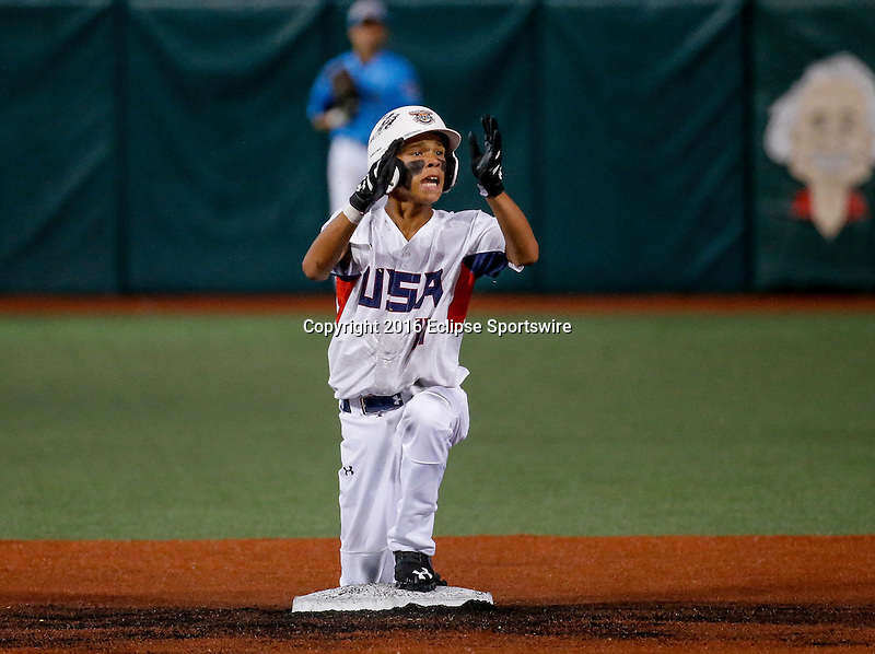 ABERDEEN, MD - AUGUST 06: Simeon Howard #17 of Kennewick (WA) reacts after hitting a weed off double in the 1st inning in the World Championship game between Japan and Team USA (Pacific Northwest) during the Cal Ripken World Series at The Ripken Experience Powered by Under Armour on August 6, 2016 in Aberdeen, Maryland. (Photo by Ripken Baseball/Eclipse Sportswire/Getty Images)