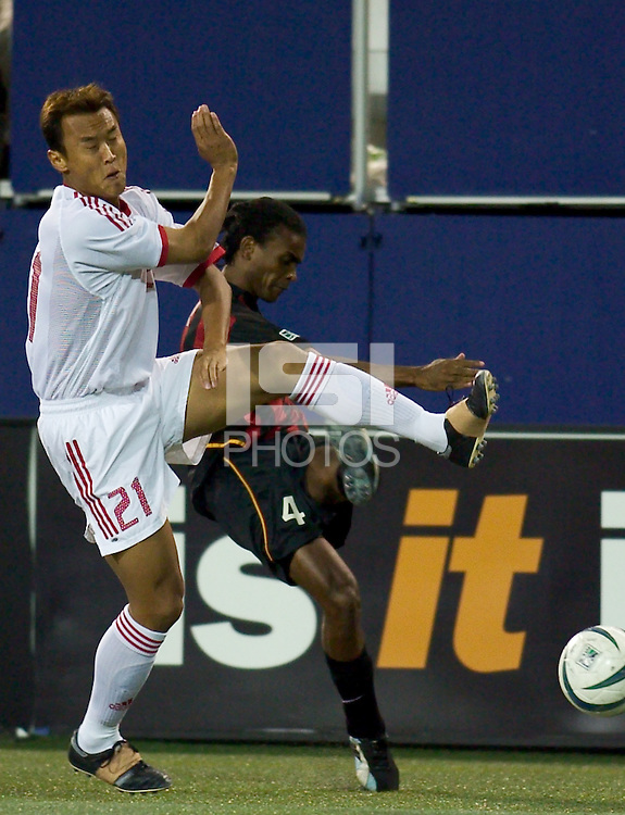 Xu Yuniong of China attempts to block a cross from Edgar Bartolomeu of the MetroStars. The NY/NJ MetroStars defeated the national team of China 2-1 in a friendly on 9/09/03 at Giant's Stadium, NJ..