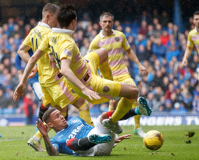 James Tavernier slides in to win the ball
