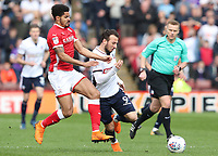 Bolton Wanderers' Adam Le Fondre and Barnsley's Adam Chicksen<br /> <br /> Photographer Rachel Holborn/CameraSport<br /> <br /> The EFL Sky Bet Championship - Barnsley v Bolton Wanderers - Saturday 14th April 2018 - Oakwell - Barnsley<br /> <br /> World Copyright &copy; 2018 CameraSport. All rights reserved. 43 Linden Ave. Countesthorpe. Leicester. England. LE8 5PG - Tel: +44 (0) 116 277 4147 - admin@camerasport.com - www.camerasport.com